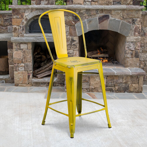 """Our Commercial Grade 24"""" High Distressed Yellow Metal Indoor-Outdoor Counter Height Stool with Back is on sale now."""